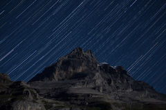 Stars over the Eiger Mountain. Star trails over the Eiger Mountain, in the Bernese Oberland region in Switzerland stock photo