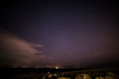 Stars over Galway and lighthouse Stock Photography
