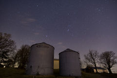 Stars over Grain Bin. The night sky hanging over grain bins on a midwest farm royalty free stock images