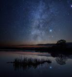 Stars over the lake. A picture of starry sky over the lake Stock Photo