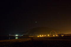 The stars over the night sea city on the beach. Stock Images