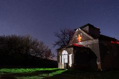 Stars over an old abandoned rural church stock photography