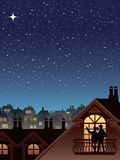 Stars over a town. Two people are looking at the sky and stars Stock Photography