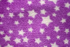 Stars in purple velvet texture Stock Image