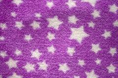 Stars in purple velvet texture. Background stock image