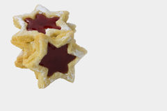 Stars with raspberry jam. Delicious raspberry stars invite you to nibble Royalty Free Stock Images