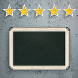 5 Stars Rating Blackboard Concrete. 5 rating stars with blackboard on the concrete background Stock Photo