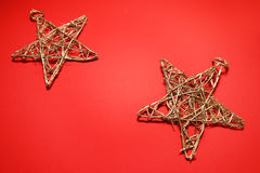 Stars on red. Christmas star decors Royalty Free Stock Photography