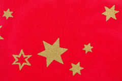 Stars on red fabric Stock Images