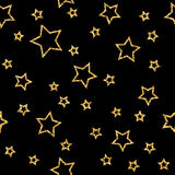 Stars seamless pattern gold. And black retro background. Abstract bright golden design for wallpaper, christmas decoration, confetti, textile, wrapping. Symbol Stock Photography