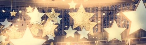 Stars shape show celebrity background with spotlights soffits vintage yellow golden colors as stage performance background royalty free stock photo