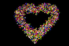 Stars shaped in a heart. On black background Royalty Free Stock Images