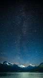 Stars shine in the sky over the fjords Stock Image