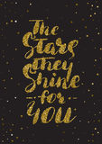 The stars, they shine for you - hand painted ink brush pen calli. Graphy. Gold glitter textured inspirational motivational quote isolated stock illustration