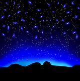 Stars in the sky at night over mountain  background Royalty Free Stock Image