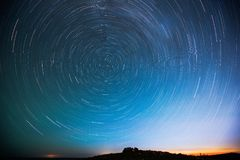 The starry sky that twirls at night. The stars in the sky revolve around the North Star. The stars are clearly visible far from the city Stock Photo