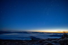 Stars in the sky at sunrise. Stars in the sky at dawn in the Carpathians stock photography
