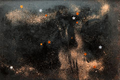 Stars and Snow Flakes on Glittery Background Stock Photography