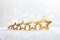 5 stars snow sparkles gold Royalty Free Stock Photos