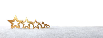 5 stars snow white gold. Five golden stars on snow isolated on white, background, copy space, panel format Royalty Free Stock Photo