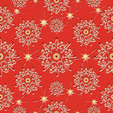 Stars and snowflakes on a red background. Stock Photography
