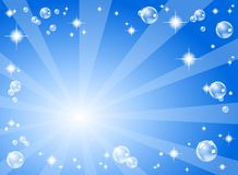 Stars and soap bubbles in front of a blue backgrou Stock Photos
