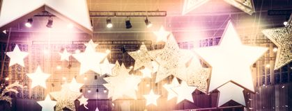 Stars spotlights soffits as finest hour celebrity show stage performance background with golden pink lights. Shining Stars spotlights soffits as finest hour stock image