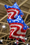 Stars and Stripes. At the Dallas auto show in 2003, patriotic star-shaped balloons decorate the exhibit hall stock photo