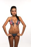 Stars and stripes. Beautiful young multiracial woman in a stars and stripes bikini Stock Photos