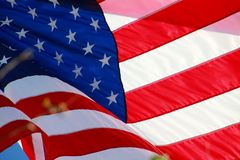 American Flag. The stars and stripes of the American flag wave and flutter patriotically in the afternoon sun Royalty Free Stock Photos