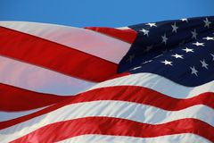 American Flag. The stars and stripes of the American flag wave and flutter patriotically in the afternoon sun Stock Photo