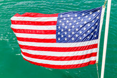 Stars and Stripes. The American flag waving over water Stock Photos