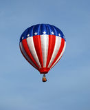 Stars and Stripes balloon. Stars and stripes hot air balloon against clear sky Royalty Free Stock Photo