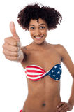 Stars and stripes bikini model showing thumbs up Royalty Free Stock Photo