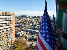 The Stars and Stripes in Brooklyn. Photo of The Stars and Stripes & x28;Flag of the United States of America& x29; with a view over the houses in Brooklyn, NYC Royalty Free Stock Photo
