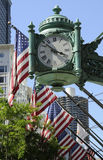 Stars and Stripes with company clock Chicago USA Royalty Free Stock Photography