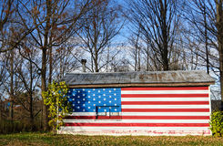 Stars and Stripes flag painted on a rural american house Royalty Free Stock Photos