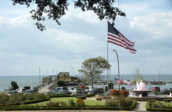 Stars and Stripes flying above Fairhope Pier in Alabama USA Royalty Free Stock Images