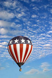 Stars and Stripes Hot Air Balloon. A stars and stripes hot air balloon in a beautiful cloudy sky Royalty Free Stock Photography