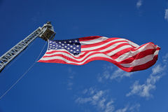 Stars & Stripes On Hydraulic Platform Boom. The American flag flies from a firefighting snorkel or hydraulic aerial work platform Stock Photography