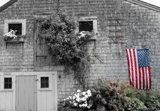 Stars and stripes in red white blue. Beautiful wall of cottage featuring the american flag in focal black and white Royalty Free Stock Image