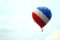 Stars and Stripes in the Sky. A patriotic hot air balloon flies at a Texas balloon festival just a couple of weeks after the Sept. 11, 2001, terrorist attacks stock photography