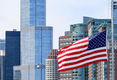 Stars and stripes and skyscrapers. Chicago, USA - May 24, 2014: The American flag waving in front of a part of the Chicago Skyline including the Trump Tower Stock Photo
