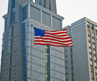 Stars and Stripes of USA flag before a building. Symbol of hope and dreams of the United States flag Royalty Free Stock Photography