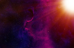 Stars and Sun  Rays Background. Dense background of stars and stardust seen through the light rays of a close star Royalty Free Stock Photo