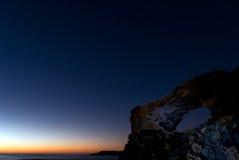 Stars at sunrise. A shot o a starry sky at sunrise in the coast of Arinaga stock photography