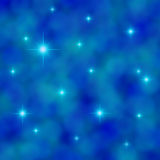 Stars twinkling in a cloudy blue sky Stock Photos