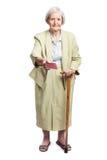 Starsza kobieta daje paszportowi nad bielem Fotografia Stock
