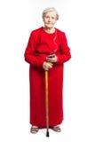 Starsza kobieta słucha muzyka nad bielem zdjęcia royalty free
