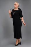 Starsza kobieta w eleganckim odziewa Obrazy Royalty Free